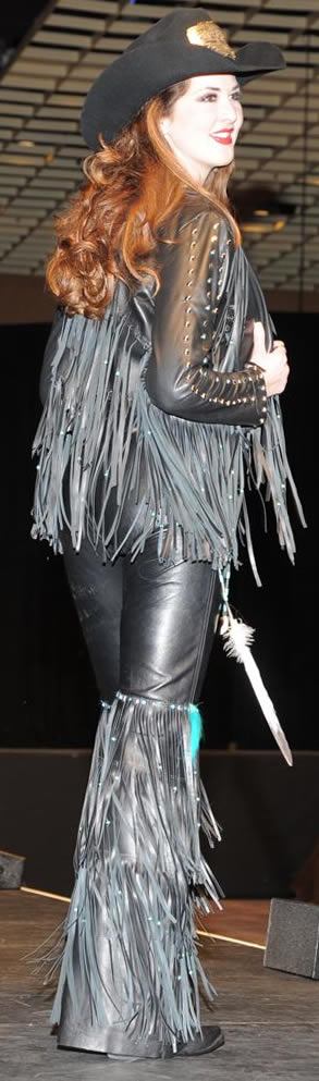 Morgan Blackhurst, miss Rodeo Tennessee wearing black lambskin jacket and fringed chaps